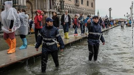 Local police began cleaning people from St. Mark's Square on Monday because of the floods.