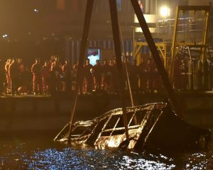 China bus sinks from bridge and kills 15 after driving woman
