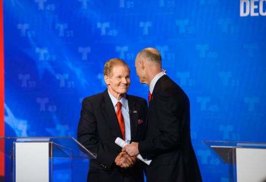 Senator Bill Nelson and Governor Rick Scott manipulate the Senate's first debate in Miramar, FL on Tuesday.