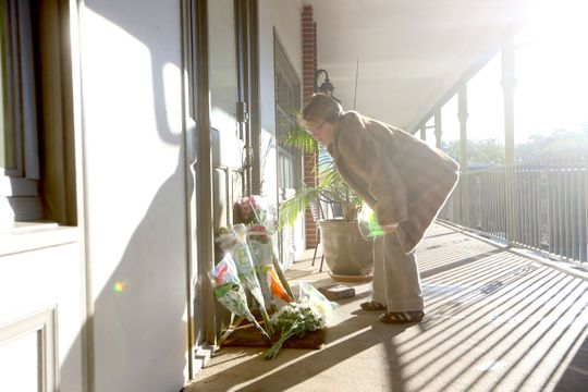 The morning after shooting took place at Hot Yoga Tallahassee, members of the community leave flowers in honor of the victims on Saturday 3 November 2018.