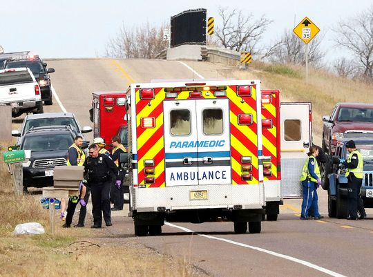 Emergency medical staff gathered on the scene of an accident during a visit on November 3, 2018, to Lake Hallie, Wisconsin, which killed three girl detectors and an adult.