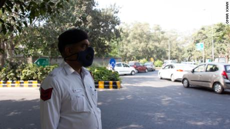Delhi Rohtas Singh's traffic officer wears a specially designed pollution mask.