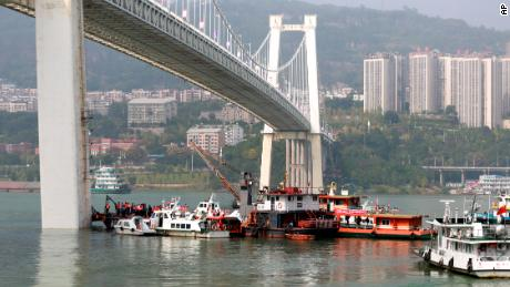 Rescuers are conducting research and rescue at the site where a bus has been sank from a bridge on the Yangtze River in Wanzhou on October 28.