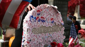 I voted stickers placed in the grave Susan B. Anthony
