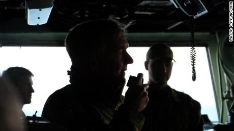 Admiral James C. Fogo III addresses service staff on the dubious USS Iwo Jima before training in Iceland.
