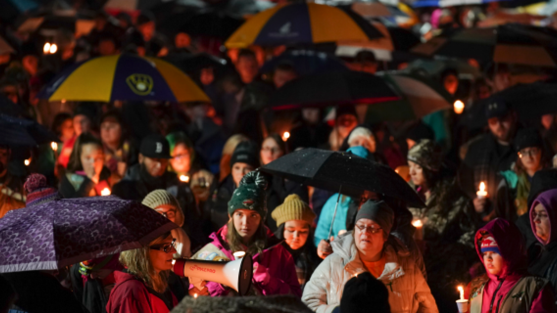 Serri Jasper, a member of the board of the girl and a consultant to the Halmstad Primary School, leads the candlelight vigilance program at Chippewa Falls School, Wis., Sunday night, November 4, 2018. The West Wisconsin community Sunday grieves deaths of three girl detectors and a parent gathering garbage on Saturday along a rural motorway when police say a truck has jumped out of the way and hit them before accelerating. The 21-year-old driver, Colten Treu of Chippewa Falls, rushed but later surrendered. He will be accused of four homicide charges, the Sgt Police Hallie Lake. Daniel Sokup said. (Jeff Wheeler / Star Tribune via AP)
