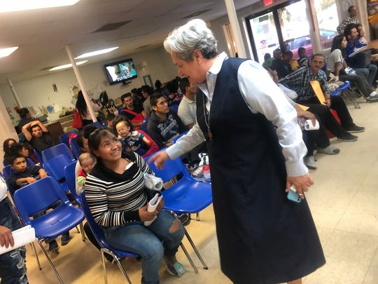 Sister Normal Pimentel, executive director of Rio Grande Catholic Philanthropic Organizations and director of the Humanitarian Recreation Center in McAllen, Texas, talks with a recently arrived immunity.