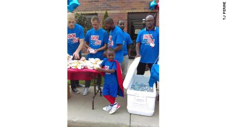Austin Perine travels to Detroit to feed the homeless on his over-devoted red cape.