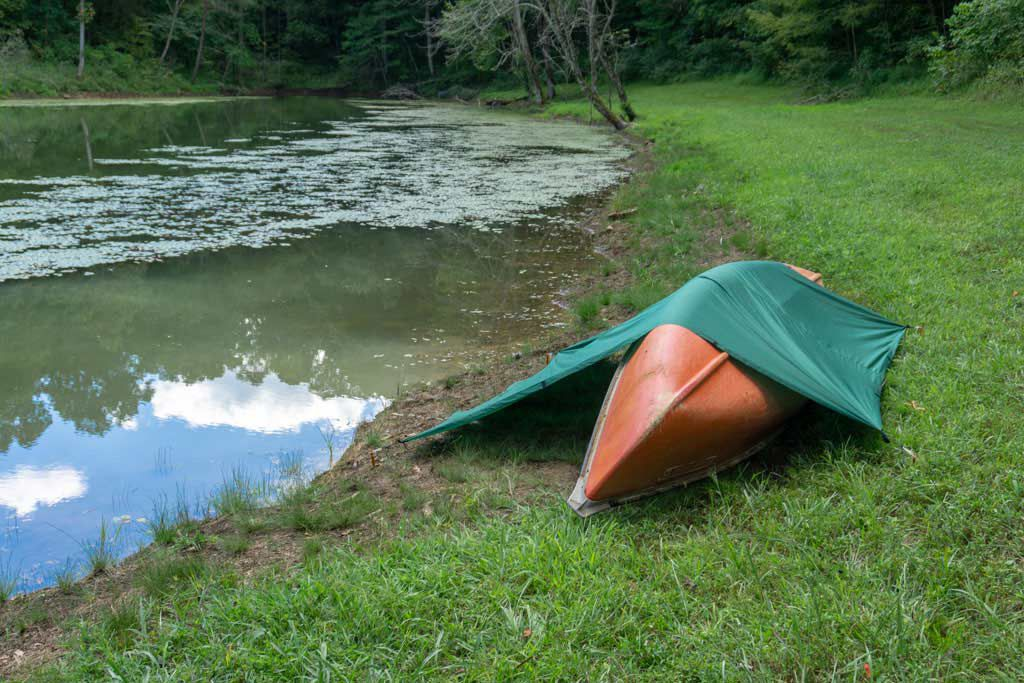 A canoe and a tarp make for a great shelter choice.