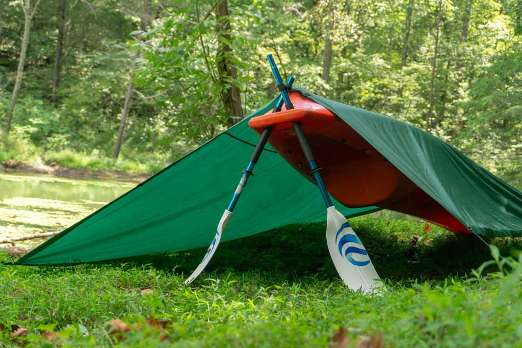 A kayak, curtain and spoonful of burglary are all you need for a great rowing shelter.